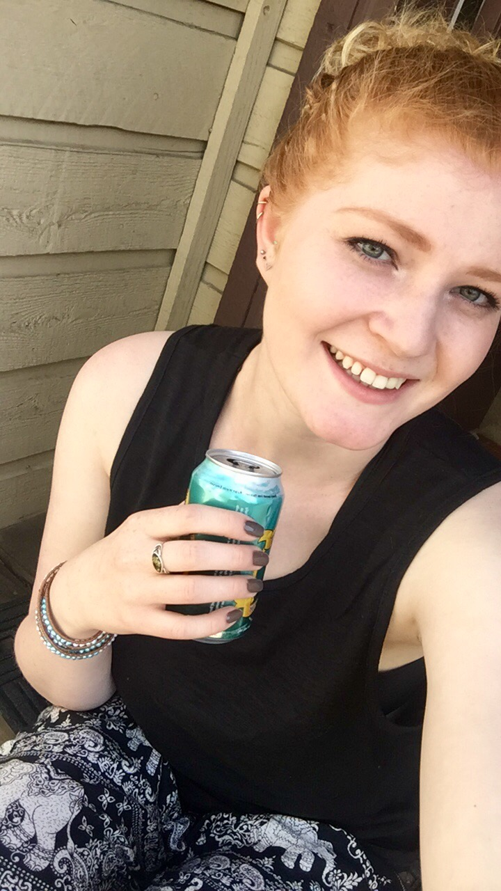 Molly: redheaded selfie of girl smiling holding can
